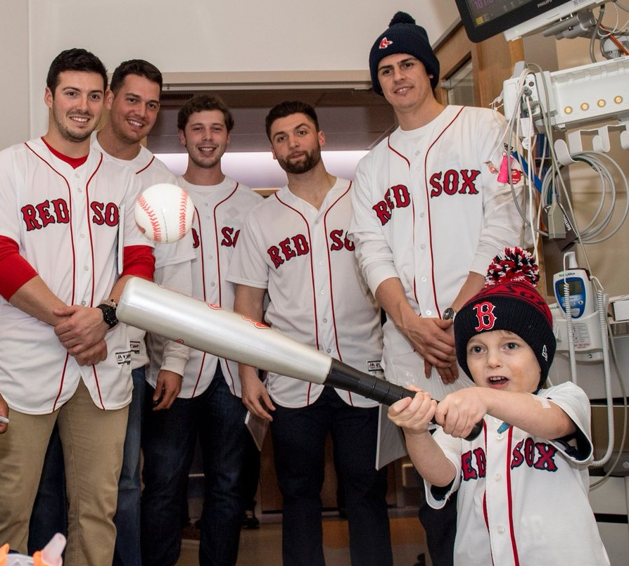 A photo of Ari Schultz with the Boston Red Sox tweeted by the baseball team following the 5 year-old's death on July 21, 2017
