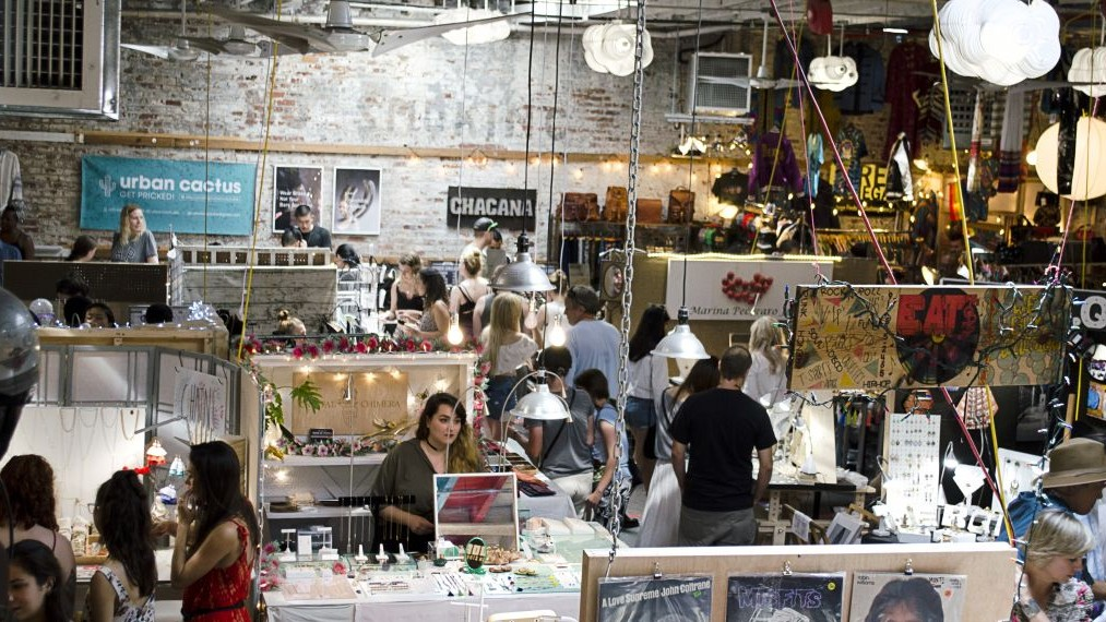 The interior of the Williamsburg, Brooklyn location of Artists and Fleas, a market of curated crafts and goods Courtesy Amy Abrams)