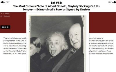 The Nate D. Sanders auction house advertises the sale of an iconic photo of Albert Einstein taken in 1951 and signed by the physicist. (Nate D. Sanders, Inc)