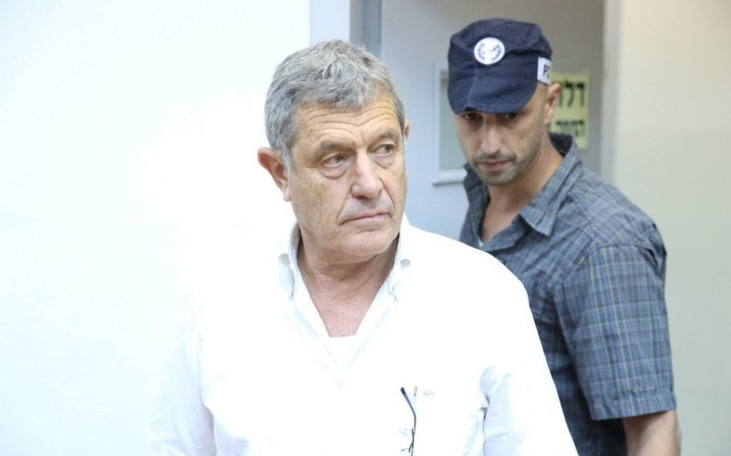 Miki Ganor, arrested in the submarine affair also known as 'Case 3000,' is brought for a court hearing at the Magistrate's Court in Rishon Lezion, July 10, 2017. (Moti Kimchi/Pool)
