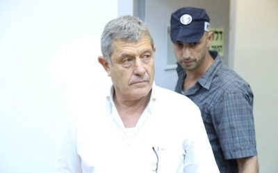 Miki Ganor, arrested in the submarine affair also known as 'Case 3000,' is brought for a court hearing at the Magistrate's Court in Rishon Letzion, July 10, 2017. (Moti Kimchi/Pool)
