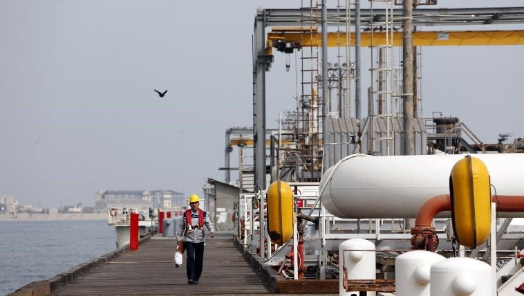 12 2017 shows an Iranian laborer walking the platform of the oil facility in the Khark Island on the shore of the Gulf