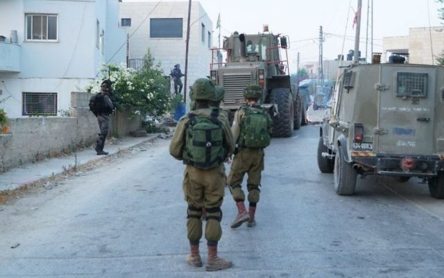 IDF forces operate in the West Bank settlement of Halamish on July 23, 2017. (IDF spokesman)
