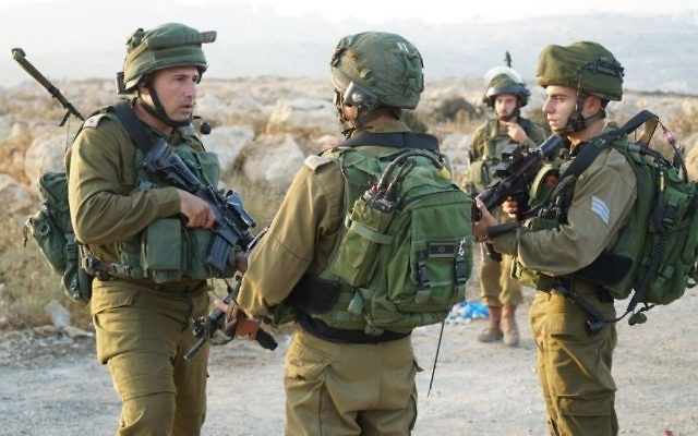 Illustrative: IDF forces operate in the West Bank settlement of Halamish on July 23, 2017. (IDF spokesman)