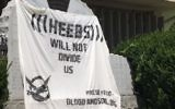 Illustrative image of an anti-Semitic banner draped over a Holocaust memorial in Lakewood, New Jersey, July 2, 2017. (Courtesy ADL)