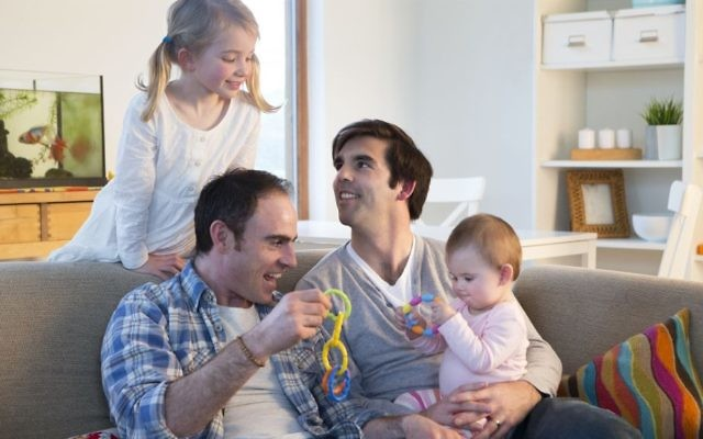 Illustrative picture of a same-sex couple with their children (DGLimages/iStock via Getty images)