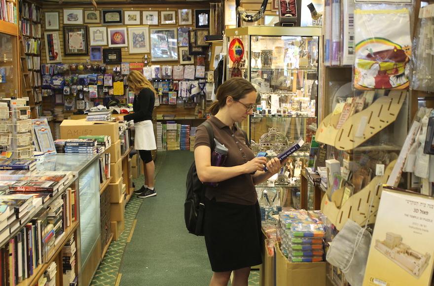 Customers browsing at West Side Judaica, July 26, 2017. (Ben Sales/JTA)