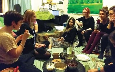 Shabbat their own way: Food, song and worship at Ronit Delgado's Brooklyn apartment. (AMY SARA CLARK/JW)
