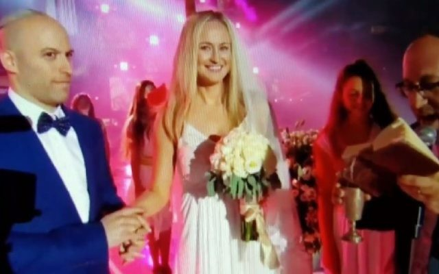 Canadian hockey player Avi Steinberg and his girlfriend of four years, and recent convert to Judaism, Rachel Dixon, get married at the opening ceremony of the Maccabiah 20th Games in Jerusalem, July 6, 2017. (Screenshot)