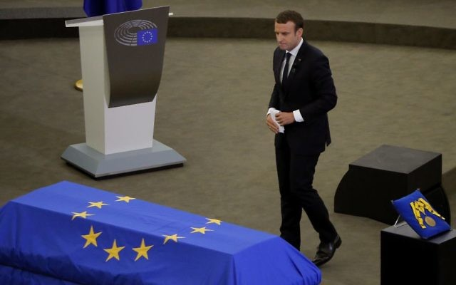 French President Emmanuel Macron walks past Helmut Kohl's coffin during a eulogy ceremony for former German Chancellor Helmut Kohl, at the European Parliament in Strasbourg, eastern France, July 1, 2017.  (AP Photo/Michel Euler)