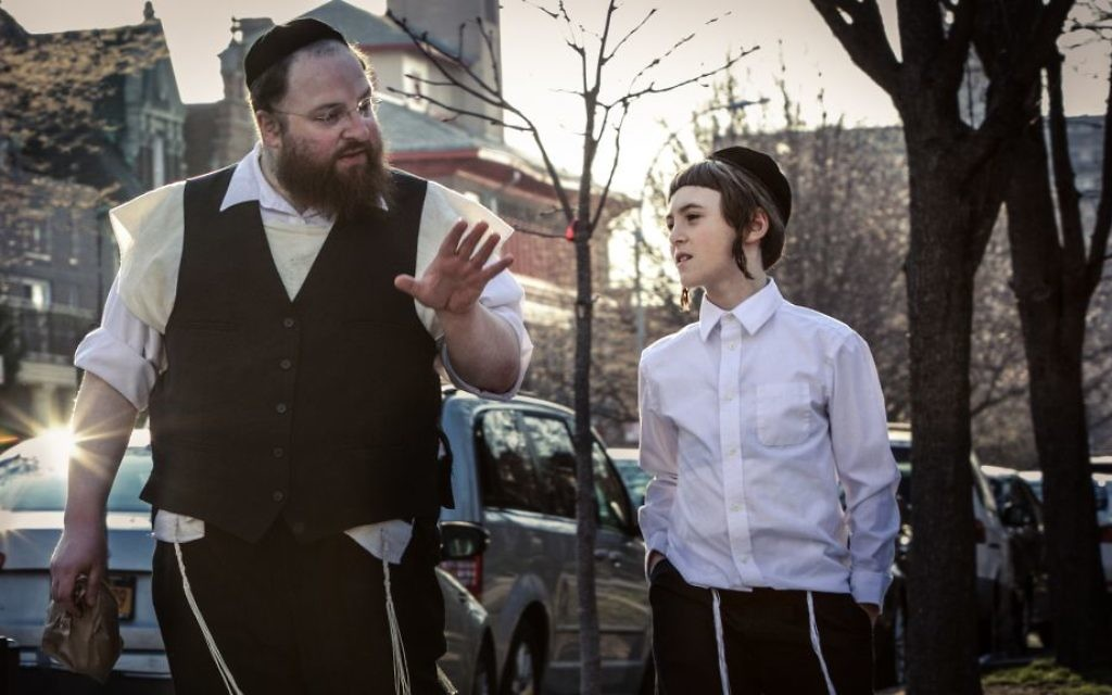 "Menashe Lustig, left, and Ruben Niborski in the film ""Menashe."" (Federica Valabrega/A24/via JTA)"