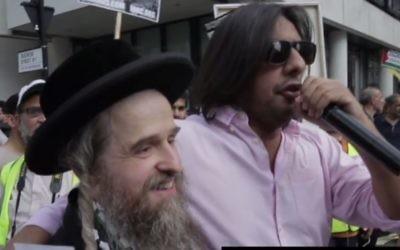 Nazim Ali (r), of Islamic Human Rights Commission (IHRC), chants anti-Zionist rhetoric at London's Al-Quds Parade on June 18. 2017. (Screen capture: YouTube)