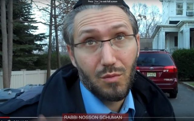 Rabbi Nosson Schuman, wounded in a firebombing attack on the synagogue of his congregation, Congregation Beth El in Rutherford, in 2011. (Screen capture YouTube)