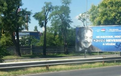 An anti-Soros billboard, with a swastika and Soros's name replaced by Viktor Orban's, seen in Budapest on July 17, 2017. (Raphael Ahren/Times of Israel)