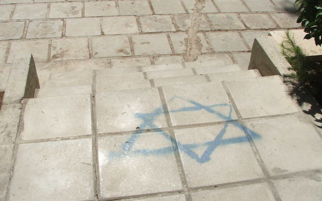 The Star of David outside the University of Jordan's law department in 2006 was there so visitors could step all over the Jewish and Israeli symbol on their way to class. (Uriel Heilman)