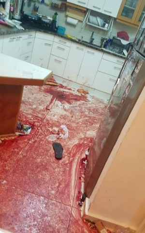A photo released by the Israeli army showing the scene of a terror attack in a home in the settlement of Halamish on Friday, July 22, 2017. (IDF)