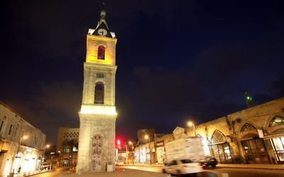 Night view of the clock tower at the entrance to Jaffa, June 30, 2008. (Miriam Alster/Flash90)