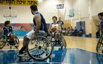 The USA looks to score against Israel in the first wheelchair basketball competition of the 2017 Maccabiah Games, July 9, 2017. (Luke Tress/Times of Israel)