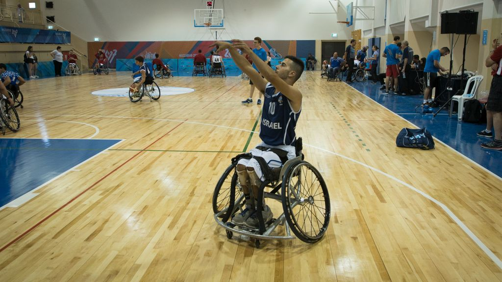 Israel's wheelchair basketball team warms up before a game against a team from the United States, July 9, 2017. (Luke Tress/Times of Israel)