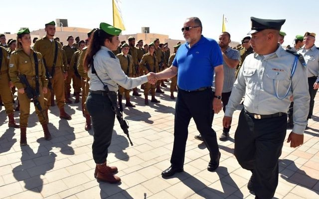 Defense Minister Avigdor Liberman attends the inauguration of the IDF's new combat training base for mixed-gender units in the Negev desert on August 16, 2017. (Ariel Hermoni/Defense Ministry)