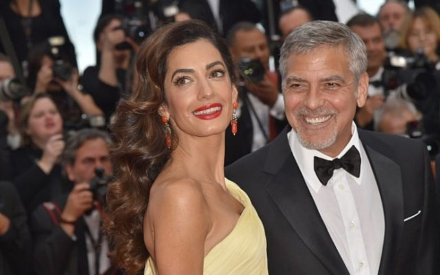 US actor George Clooney (R) and his wife Amal Clooney at the 69th Cannes Film Festival in Cannes, southern France, May 16, 2016. (LOIC VENANCE / AFP)