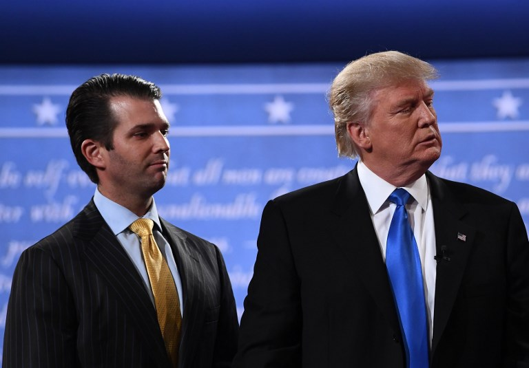 Then-Republican nominee Donald Trump (R) standing with his son  Donald Trump Jr. after the first presidential debate at Hofstra University in Hempstead, New York, September 26, 2016 (AFP Photo/Jewel SAMAD)