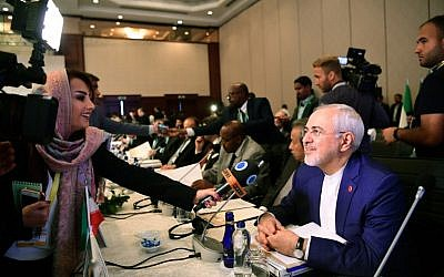 Iranian Foreign Minister Mohammad Javad Zarif, right, speaks to media as he attends the Executive Committee Meeting of Organization of Islamic Cooperation on August 1, 2017 in Istanbul.  (AFP/ OZAN KOSE)