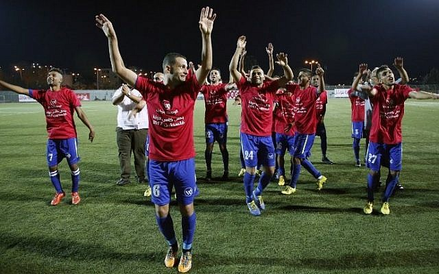 Players from Gaza's Shabab Rafah soccer team celebrate following their victory in the second leg of the Palestinian Cup final at the stadium in the city of Dura, near the West Bank town of Hebron, on August 4, 2017. (AFP Photo/Hazem Bader)