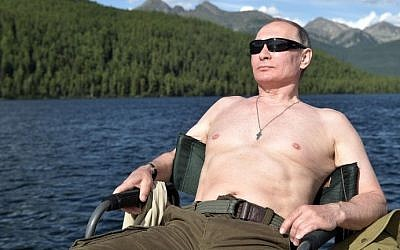 Russian President Vladimir Putin sunbathes during his vacation in the remote Tuva region in southern Siberia. The picture taken between August 1 and 3, 2017. (AFP Photo/Sputnik/Alexey Nikolsky)