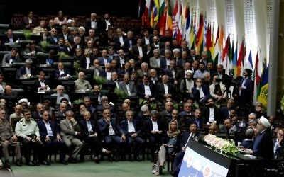 Iran's President Hassan Rouhani (2-R) delivers a speech after being sworn in before parliament in Tehran, on August 5, 2017. (AFP PHOTO / ATTA KENARE)