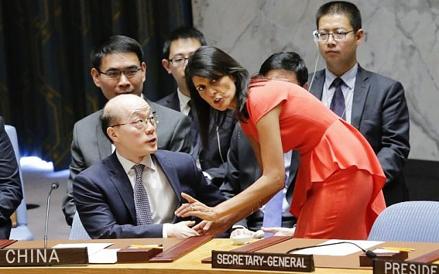 US Ambassador to the United Nations Nikki Haley (R) speaks with Chinas Ambassador to the United Nations Liu Jieyi before voting on a US-drafted resolution toughening sanctions on North Korea, at the United Nations Headquarters in New York, on August 5, 2017. (AFP/Eduardo Munoz Alvarez)