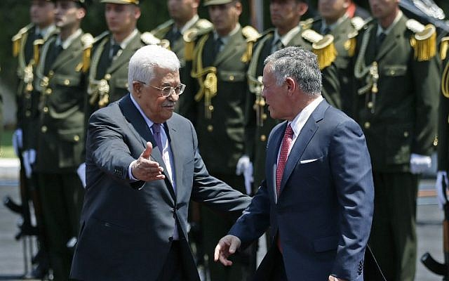 Jordan's King Abdullah II (right) speaks with Palestinian Authority President Mahmoud Abbas upon his arrival in the West Bank city of Ramallah on August 7, 2017. (AFP PHOTO / ABBAS MOMANI)