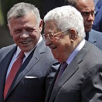 Jordan's King Abdullah II, left, speaks with Palestinian Authority President Mahmuod Abbas upon his arrival in the West Bank city of Ramallah, August 7, 2017. (AFP/Ahmad GHARABLI)