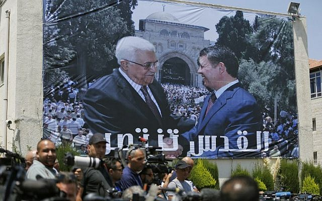 A photo montage of Jordan's King Abdullah II and Palestinian Authority President Mahmoud Abbas shaking hands in front of the Temple Mount / Al-Aqsa mosque compound is seen on a building during a welcome ceremony for the Jordanian King in the West Bank city of Ramallah on August 7, 2017. (AFP PHOTO / ABBAS MOMANI)