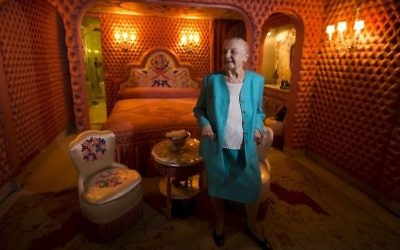 This file photo taken on May 31, 2013 in Paris shows Helene Martini, nicknamed the 'Empress of the night,' who overlooked 17 cabarets and directed the 'Folies Bergeres' cabaret for 37 years, posing for a photograph in her room decorated by Franco-Russian artist Romain de Tirtoff, also known as 'Erte'. (AFP / JOEL SAGET)