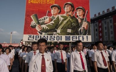 A propaganda poster is displayed during a rally in support of North Korea's stance against the US, on Kim Il-Sung square in Pyongyang on August 9, 2017. (AFP PHOTO / KIM Won-Jin)