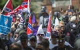 Members of the Ku Klux Klan and others arriving for a rally calling for the protection of Confederate monuments in Charlottesville, Virginia, July 8, 2017. (AFP Photo/Andrew Caballero-Reynolds)