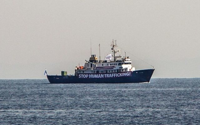 This file photo taken on August 05, 2017 shows a banner that reads, 'Stop Human Trafficking' attached to the side of the C-Star vessel as it sails in the Mediterranean Sea, 20 nautical miles off the Libyan coast. (AFP PHOTO / Angelos Tzortzinis)