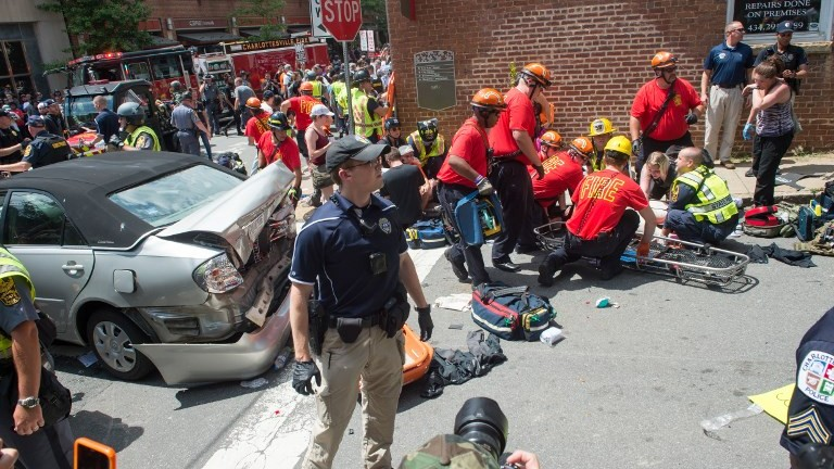 A woman receives first-aid after a car ran into a crowd of protesters in Charlottesville Virginia