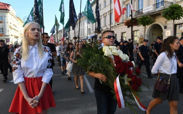 Far-right wing extremists march through the downtown to celebrate the Polish Army Day, marking the victory of Polish troops against the Bolshevik army in 1920,on August 15, 2017 in Warsaw. (AFP/ JANEK SKARZYNSKI)
