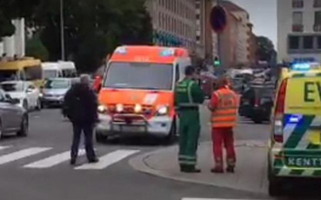 A video grab taken from Twitter on August 18, 2017 shows officials standing in a street in the Finnish city of Turku where several people were stabbed.  (Juha Riihimaki/AFP)