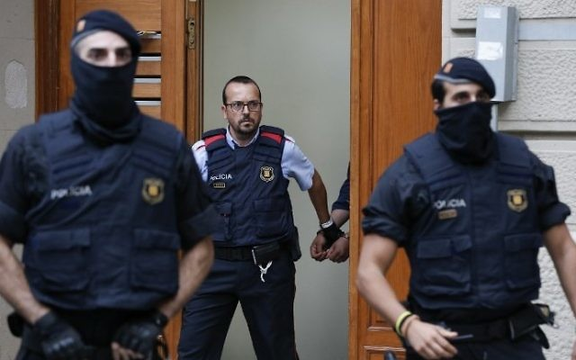Catalan police officers detain a suspect in Ripoll during a search linked to the deadly terror attacks in Barcelona and the seaside resort of Cambrils, on August 18, 2017. (AFP Photo/Pau Barrena)