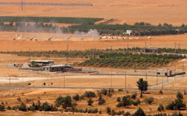 A general view taken on August 19, 2017, shows artillery being fired from a Lebanese military base in a mountainous area near the eastern town of Ras Baalbek, as Lebanese troops launched an offensive against the Islamic State group on the country's eastern border with Syria, seeking to drive the jihadists from a long-time stronghold. ( AFP PHOTO / STRINGER)