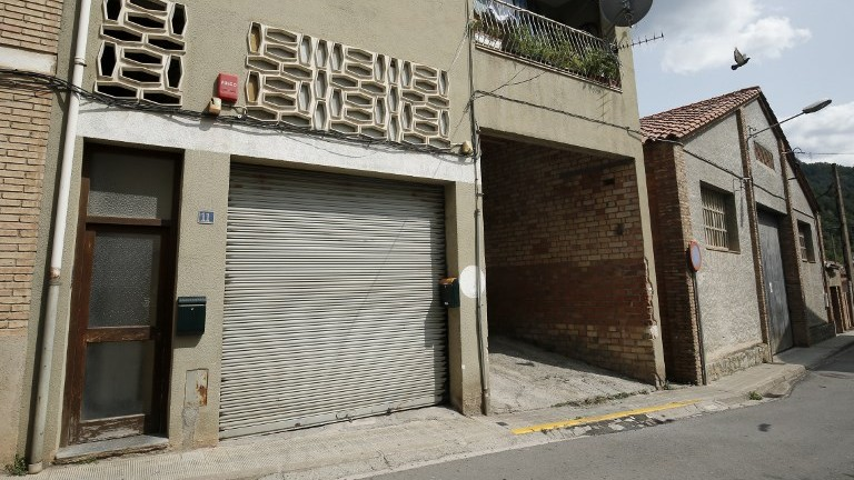A picture taken on August 19, 2017, shows a building (L) allegedly used as a mosque by imam Abdelbaki Es Satty in Ripoll, Spain. (AFP Photo/Pau Barrena)