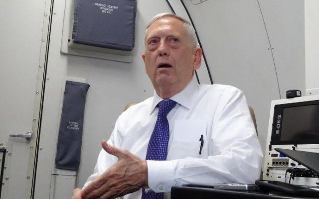 US Defense Secretary James Mattis speaks to reporters on board a flight to Jordan, on August 20, 2017. (AFP Photo/Paul Handley)