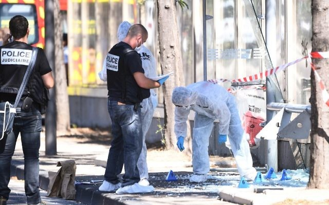 French criminal police join forensic police as they search the site following a car crash on August 21, 2017, in the southern Mediterranean city of Marseille that killed at least one person.( AFP PHOTO / Boris HORVAT)