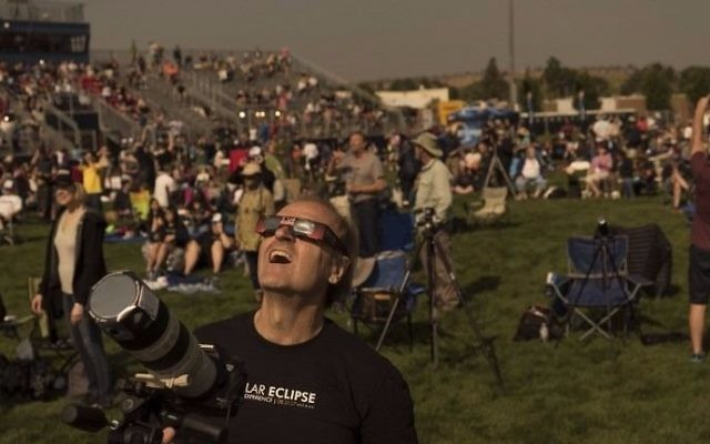 Steve Kaltenhauser of Calgary, Canada, watches with the crowd during a total solar eclipse from the Lowell Observatory Solar Eclipse Experience on August 21, 2017 in Madras, Oregon. (Stan Honda/AFP)