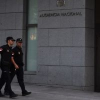 FILE - Spanish policemen walk in front of a Madrid court, on August 22, 2017, before the arrival of four men suspected of involvement in the terror cell that carried out twin attacks in Spain. (AFP Photo/Gabriel Bouys)