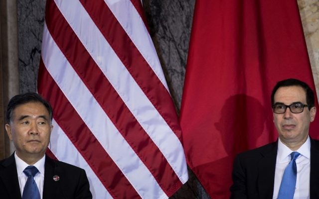 This file photo taken on July 19, 2017 shows Chinese Vice Premier Wang Yang (L) and US Secretary of the Treasury Steven Mnuchin during a US and China comprehensive Economic Dialogue at the US Department of the Treasury in Washington, DC.(AFP PHOTO / Brendan Smialowski)