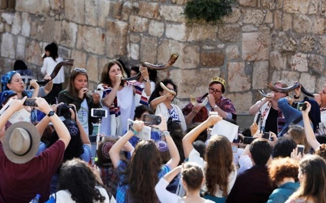 Illustrative: Members of Women of the Wall blow shofars during a prayer service marking the first day of the Jewish month of Elul, on August 23, 2017, at the Western Wall in Jerusalem's Old City. (AFP Photo/Menahem Kahana)